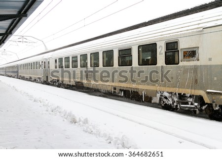 BUCHAREST, ROMANIA - JANUARY 17, 2016: Train of the National Railway Company (CFR) who arrived during a snow storm in the largest railway station in Romania - Gara de Nord - stock photo
