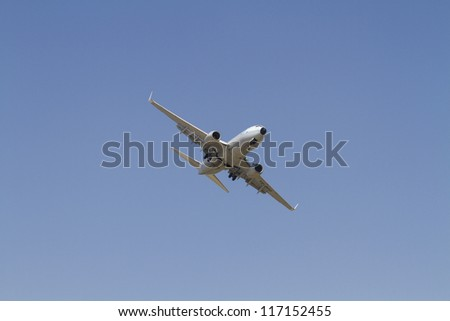 BUCHAREST,ROMANIA - JULY 21: a Boeing 737-700 performs stunts at Bucharest airshow in Bucharest, Romania on July 21, 2012.