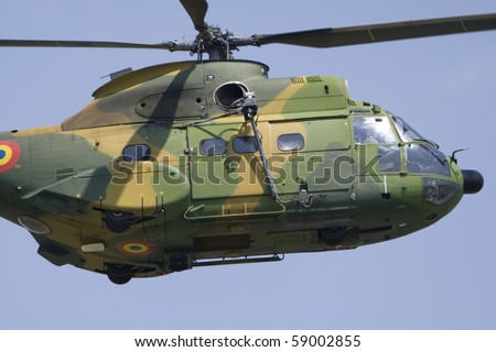 BUCHAREST, ROMANIA - JULY 17: Helicopters perform during the airshow on July 17, 2010 on Henri Coanda airport, Bucharest, Romania.
