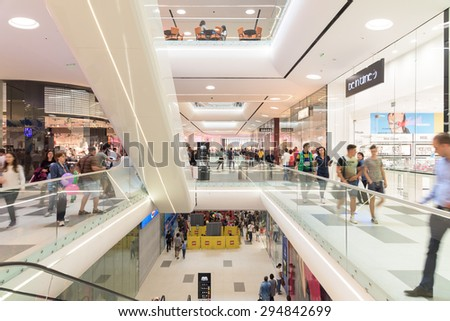 BUCHAREST, ROMANIA - JULY 08, 2015: People Crowd Rush In Shopping Luxury Mall Interior.