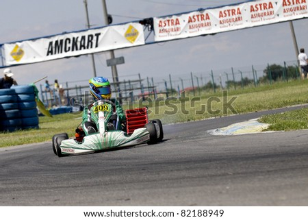 BUCHAREST, ROMANIA - JULY 31: Roberto Arcarese, number 409, competes in National Karting Championship, Round 4, on July 31, 2011 in Bucharest, Romania.