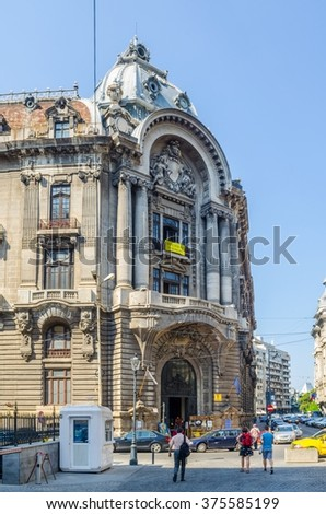BUCHAREST, ROMANIA, JULY 11, 2015: view of a minor street inside of the old town of romanian capital bucharest where people usually relax during hot summer days.