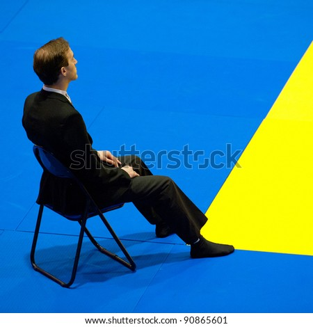 BUCHAREST, ROMANIA - JUNE 4: An unidentified arbitrator watches one of the matches in the Judo World Cup Men 2011 on June 4, 2011, Bucharest, Romania - stock photo