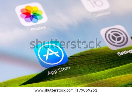 BUCHAREST, ROMANIA - JUNE 16, 2014: Apple Application Store On Apple iPad Air. In 2008, Apple launched the App Store introducing third-party app development and distribution. - stock photo