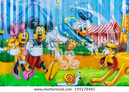 BUCHAREST, ROMANIA - JUNE 08, 2014: Disney Cartoon Characters In Youths Public Amusement Park (Tineretului Park) On Summer Day. Created in 1965 is one of the largest fun parks in south Bucharest. - stock photo