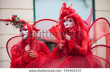 "BUCHAREST, ROMANIA - JUNE 01, 2014: Mademoiselle Paillette French company presents ""The Red Hearts"" show, inside of International Festival of Street Theater, on streets of the old center in Bucharest - stock photo"