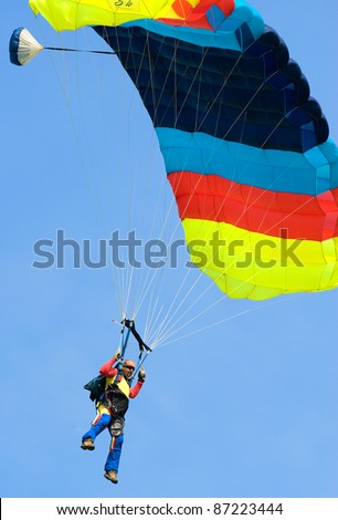 BUCHAREST, ROMANIA - JUNE 4: Paratroopers from National Skydiving Club perform at Transilv Aero Show 2011 in Clinceni on June 4, 2011 on Bucharest, Romania - stock photo