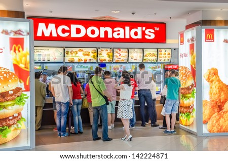 BUCHAREST, ROMANIA - JUNE 13: People buying fast-food from McDonald's Restaurant on June 13, 2013 in Bucharest, Romania. McDonald's is the main fast-food restaurant chain in Romania. - stock photo