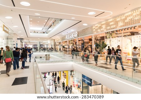 BUCHAREST, ROMANIA - JUNE 02, 2015: People Crowd Shopping In Luxury Mall Interior.