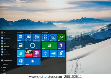 Bucharest, Romania - June17,2015: Photo of Windows 10 Insider preview running on a pc screen. Windows 10 is the new version of Windows OS; it is set for release on July 29, 2015. - stock photo