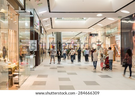 BUCHAREST, ROMANIA - JUNE 06, 2015: Shoppers Rush In Luxury Shopping Mall Interior.