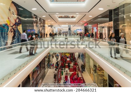 BUCHAREST, ROMANIA - JUNE 06, 2015: Shoppers Rush In Luxury Shopping Mall Interior. - stock photo