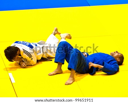 BUCHAREST, ROMANIA - JUNE 4: Unidentified Contestants participate in the Judo World Cup Men 2011 on June 4, 2011, Bucharest, Romania - stock photo
