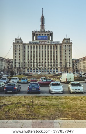 Bucharest, Romania - March 03, 2013: Front view of the House of the Free Press. Since 1956, the 104 m high edifice houses almost all printing presses and newspapers headquarters. - stock photo