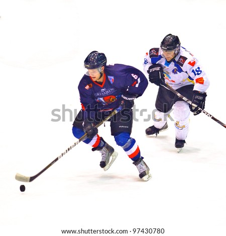 BUCHAREST, ROMANIA - MARCH 2: Unidentified hockey players compete during the Steaua Rangers (blue) vs Corona Brasov (white) at Flamaropol Stadium, score 3-2, on March 2 , 2012 in Bucharest, Romania - stock photo
