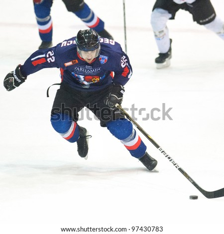 BUCHAREST, ROMANIA - MARCH 2: Unidentified hockey players compete during the Steaua Rangers (blue) vs Corona Brasov (white) at Flamaropol Stadium, score 3-2, on March 2 , 2012 in Bucharest, Romania