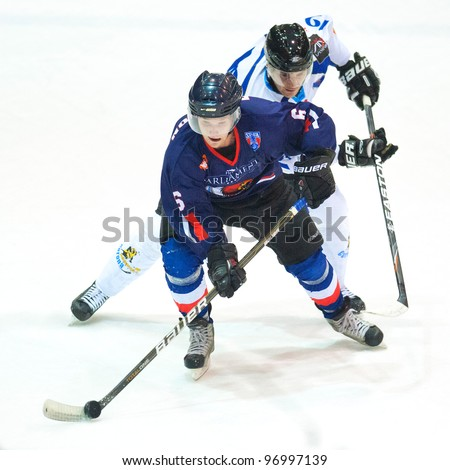 BUCHAREST, ROMANIA - MARCH 2: Unidentified hockey players compete during the Steaua Rangers vs Corona Brasovl game at Flamaropol Stadium, score 3-2, on March 2 , 2012 in Bucharest, Romania - stock photo