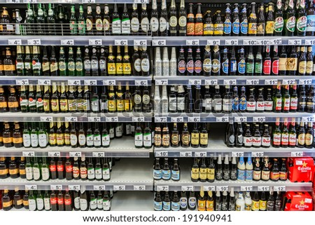 BUCHAREST, ROMANIA - MAY 08: Beer Bottles On Supermarket Shelf on May 08, 2014 in Bucharest, Romania.