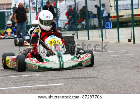 BUCHAREST, ROMANIA - MAY 15:  Dragoiu Dan competes in Europe Karting Championship, May 15, 2010, in Bucharest, Romania.