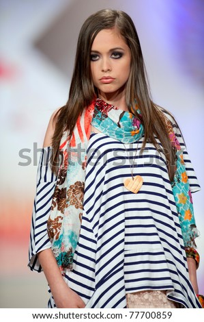 BUCHAREST, ROMANIA - MAY 7: Fashion model wears clothes from BSB collection, in Bucharest Fashion Week at World Trade Center on May 7, 2011 in Bucharest, Romania - stock photo