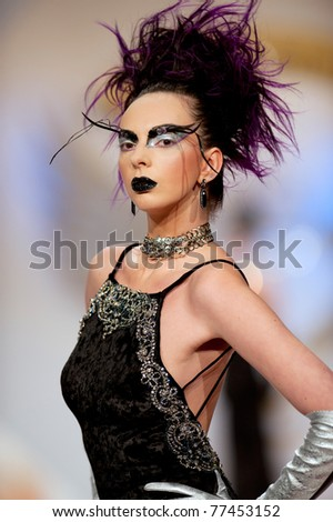 BUCHAREST, ROMANIA - MAY 7: Fashion model wears clothes made by Catalin Botezatu, Black Gold collection, in Bucharest Fashion Week at World Trade Center on May 7, 2011 in Bucharest, Romania
