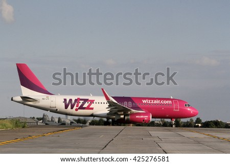 BUCHAREST, ROMANIA - May 18, 2016: Hungarian low cost airline Wizzair, Airbus taking off at Henri Coanda International Airport of Bucharest. - stock photo