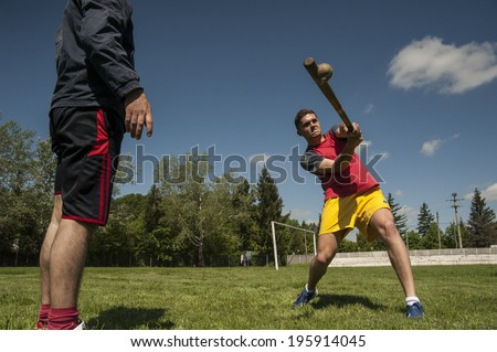 BUCHAREST, ROMANIA - MAY 8 Impact moment/Player rehearsing the battering during training before an important oina game. Oina is a traditional Romanian game which supposedly inspired baseball. Bucharest, Romania, May 8, 2014 - stock photo