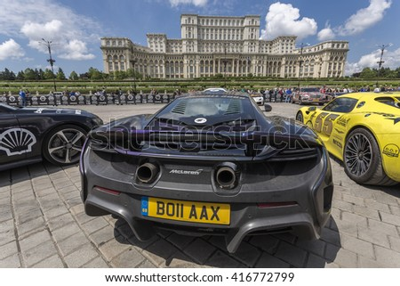 BUCHAREST, ROMANIA - MAY 7: McLaren P1 on display and the Palace of Parliament in the background on May 7, 2016 in Bucharest. The car is part of Gumball 3000 Dublin to Bucharest Charity Grid Rally. - stock photo