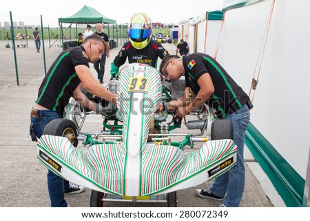 BUCHAREST, ROMANIA - MAY 16: Mecanics prepare the kart for Daniel Vasile number 93, competes in National Karting Championship, Round 1, on May 16, 2015 in Bucharest, Romania.