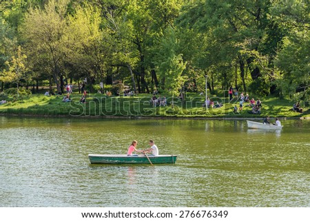BUCHAREST, ROMANIA - MAY 08, 2015: People Boat Ride On Carol Public Park Lake On Spring Day.