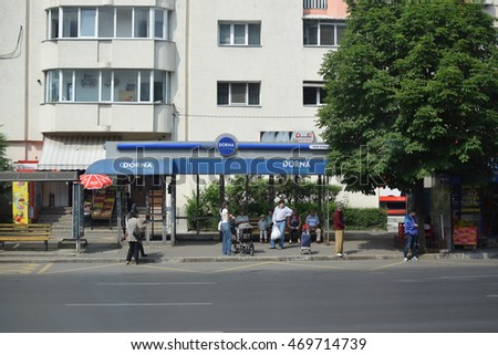BUCHAREST,ROMANIA - MAY 20, 2015: People waiting for bus at bus stop