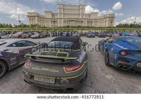 BUCHAREST, ROMANIA - MAY 7: Porsche along with other supercars on display in Constitution Square on May 7, 2016 in Bucharest. Cars are part of the Gumball 3000 Dublin to Bucharest Charity Grid Rally. - stock photo