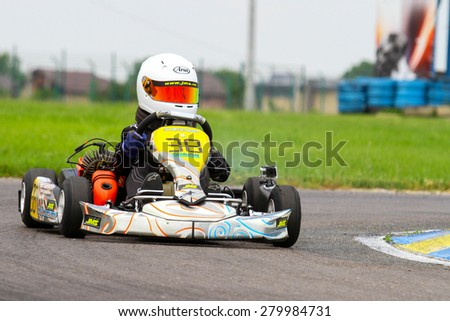 BUCHAREST, ROMANIA - MAY 16: Rares Carbunaru, number 38, competes in National Karting Championship, Round 1, on May 16, 2015 in Bucharest, Romania.