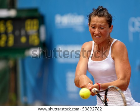 "BUCHAREST, ROMANIA - MAY 23: Romanian Alexandra Cadantu is playing during the finals of the F1 Romanian Tennis Futures at ""Dinu Pescariu Club"" on May 23, 2010 in Bucharest, Romania. - stock photo"