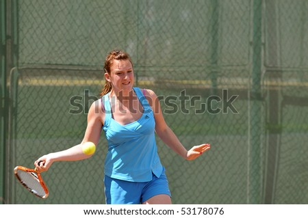 "BUCHAREST, ROMANIA - MAY 16: Romanian Alice Banica is playing during the second day of qualifications for the F1 Romanian Tennis Futures at ""Dinu Pescariu Club"" on May 16, 2010 in Bucharest, Romania. - stock photo"
