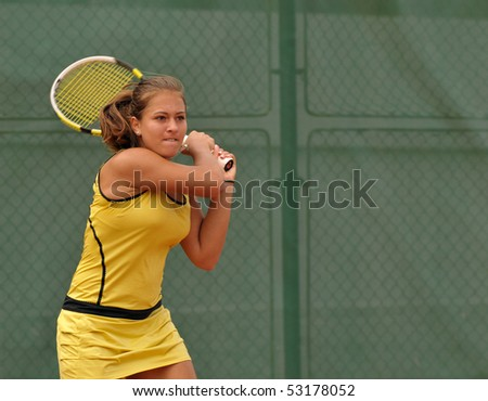 "BUCHAREST, ROMANIA-MAY 16: Romanian Elena Cadar is playing during the second day of qualifications for the F1 Romanian Tennis Futures at ""Dinu Pescariu Club"" on May 16, 2010 in Bucharest, Romania. - stock photo"