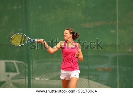 "BUCHAREST, ROMANIA-MAY 16: Romanian Patricia Tig is playing during the second day of qualifications for the F1 Romanian Tennis Futures at ""Dinu Pescariu Club"" on May 16, 2010 in Bucharest, Romania. - stock photo"