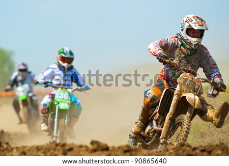 BUCHAREST, ROMANIA - MAY 14: Unidentified riders participate in the Third National Endurocross Championship on May 14, 2011 at Ciolpani in Bucharest, Romania - stock photo