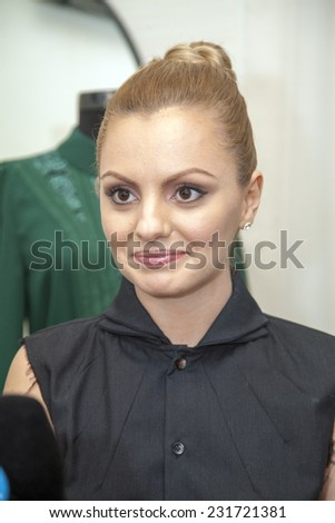 BUCHAREST, ROMANIA - NOV 19, 2014: Alexandra Stan arrives at the Opening of the first clothing store Isabel Garcia in Bucharest, Romania on November 19, 2014. - stock photo