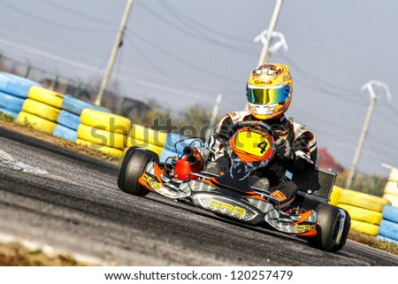 BUCHAREST, ROMANIA - NOV. 11: Babaioana Lucian, number 4, competes in Karting Cup Romania, on november 11, 2012 in Bucharest, Romania.