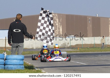 BUCHAREST, ROMANIA - NOV. 11: Simion Vladimir, number 12, competes in Karting Cup Romania, on november 11, 2012 in Bucharest, Romania.