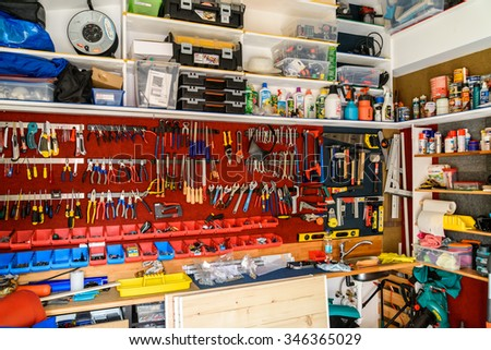 BUCHAREST, ROMANIA - NOVEMBER 30, 2015: Assortment Of Tools In Tool Shed Workshop. - stock photo