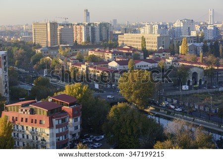 Bucharest , Romania - November 4, 2015: Bucharest, the capital of Romania - view from above, over Dimbovita river at sunset.