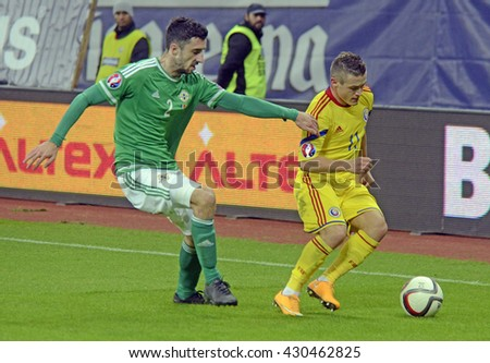 BUCHAREST, ROMANIA - NOVEMBER 14, 2014: Connor McLaughlin and Gabriel Torje pictured during the European Qualifier game between Romania and Northern Ireland on National Arena.