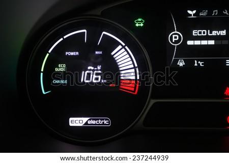 BUCHAREST, ROMANIA - NOVEMBER 28, 2014: Dashboard of Kia Soul EV electric system in Bucharest, Romania. Kia is South Korea's second-largest automobile manufacturer. - stock photo