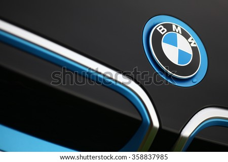 Bucharest, Romania - November 10, 2015: Detail of the vent of a BMW i3 logo on a car. BMW i3 is a five-door urban electric car developed by the German manufacturer BMW. - stock photo