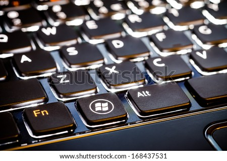 BUCHAREST, ROMANIA - NOVEMBER 30, 2012: Microsoft Keyboard With Special Microsoft Windows 8 Button Design. Released on 1 August 2012, Windows 8 is the latest operating system available from Microsoft. - stock photo