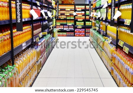 BUCHAREST, ROMANIA - OCTOBER 22, 2014: Bottles of juice on supermarket stand