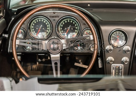 BUCHAREST, ROMANIA - OCTOBER 31, 2014: 1963 Chevrolet Corvette Stingray Interior View. The Chevrolet Corvette C2 known as the Corvette Sting Ray, is a sports car produced by General Motors. - stock photo