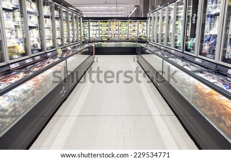 BUCHAREST, ROMANIA - OCTOBER 22, 2014: Commercial refrigerators in a large supermarket - stock photo